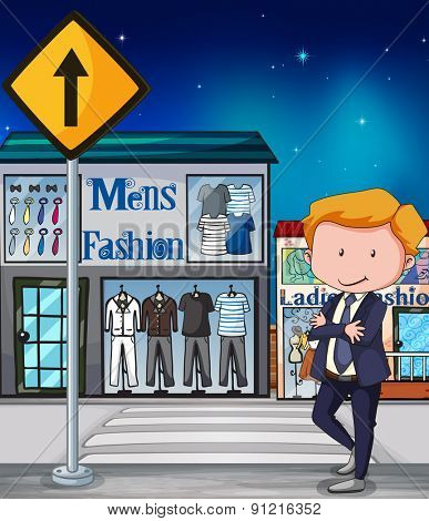 Man in suit standing in front of Mens Fashion shop