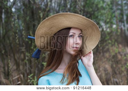 Freckled Girl In Hat On Windy Day