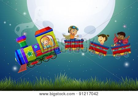 Boys and girls riding on a train at night