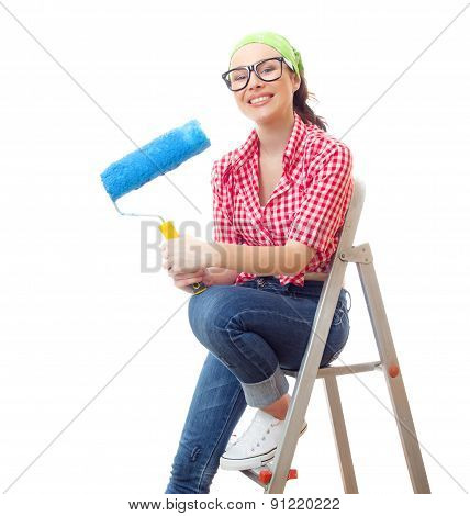 Smiling Woman Sitting On Ladder And Holding Roller, Isolated On White