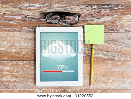 business, education, objects and technology concept - close up of tablet pc transferring data, eyeglasses and stickers with pencil on table