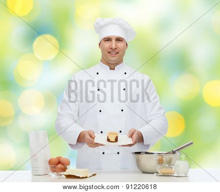 cooking, profession, haute cuisine, food and people concept - happy male chef cook baking dessert over green lights background