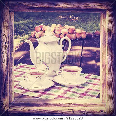 Vintage Style Tea Set In Garden.