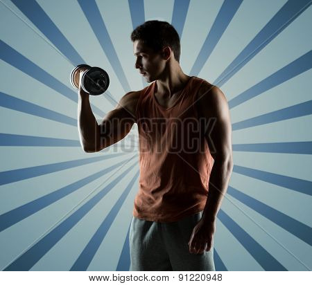 sport, fitness, weightlifting, bodybuilding and people concept - young man with dumbbell flexing biceps over blue burst rays background