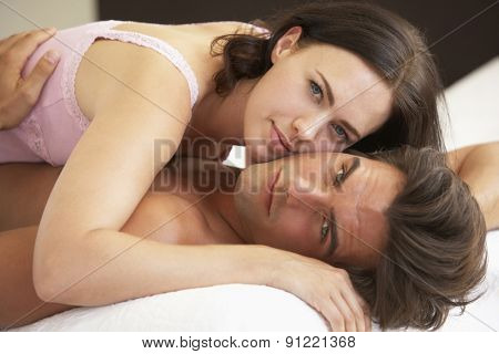Young Couple Relaxing On Bed
