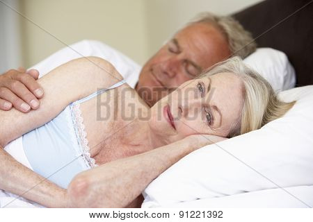 Senior Man In Bed With Worried Wife