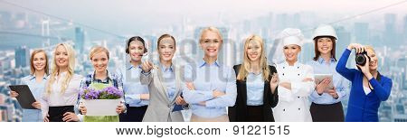 business, people and office concept - happy smiling businessman in suit pointing at you
