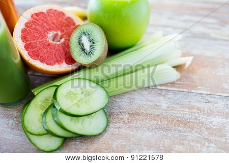 diet, vegetable food, healthy eating and objects concept - close up of ripe fruits and vegetables on table