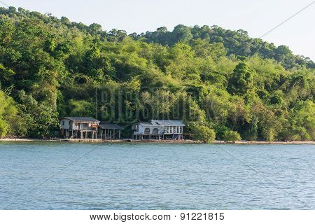 Old House On Stilts Over The Sea