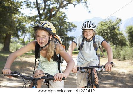 Teenage Couple Cycling Through Countryside