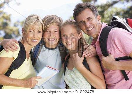 Middle Aged Family Hiking Through Countryside