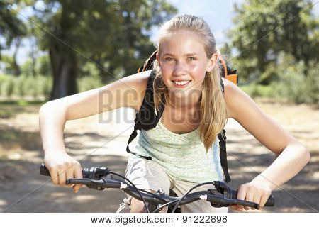 Teenage Girl Cycling Through Countryside