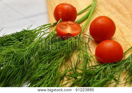 Cherry Tomatoes On The Branches Of Dill