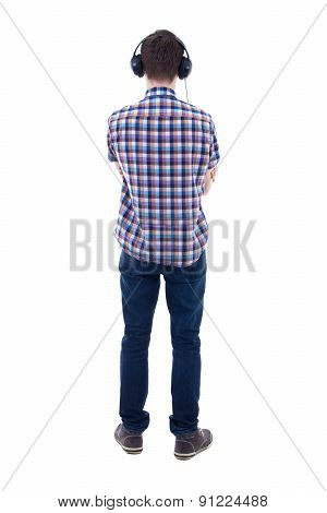 Back View Of Teenage Boy Listening Music With Headphones Isolated On White