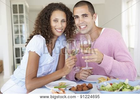 Young Couple Enjoying Meal Together
