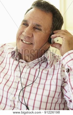 Senior Hispanic Man Wearing Headphones