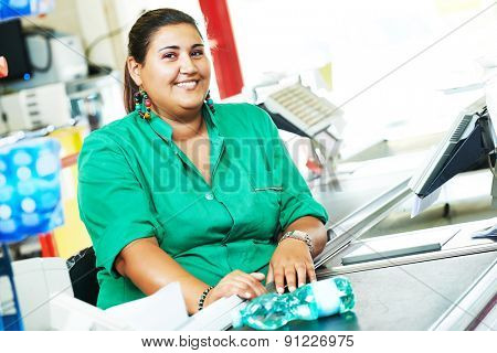 Portrait of seller assistant or cashdesk cashier worker teller in supermarket store