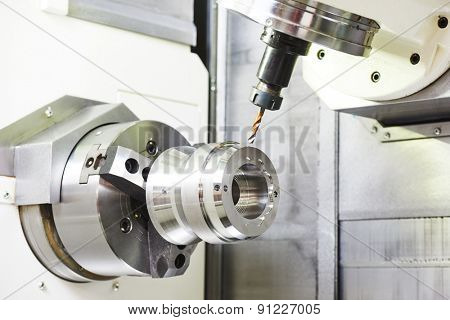 metalworking industry: drilling a hole on modern metal working machining center