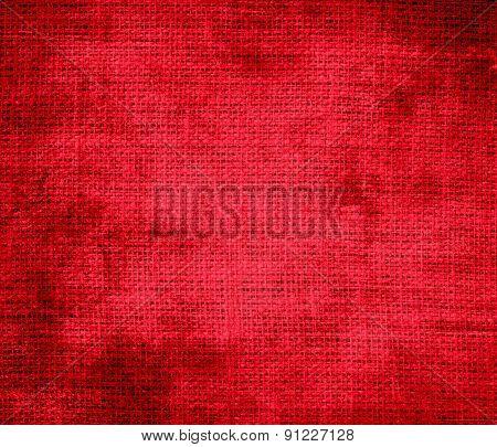 Grunge background of cadmium red burlap texture