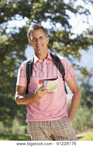 Middle Aged Man Hiking Through Countryside