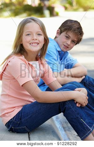 Young girl and boy outdoors