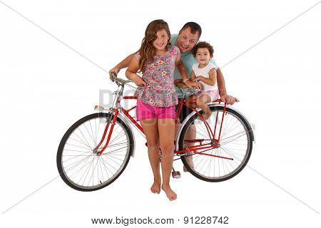 Brazilian father and daughters on an antique bike celebrating the Father's day. Family and bike isolated white background.