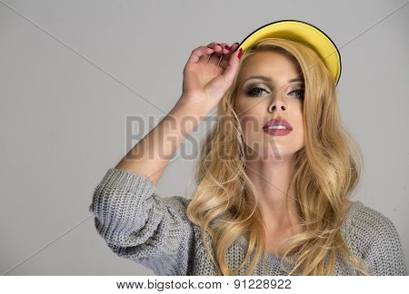 Attractive Long Haired Beautiful Woman With Cap