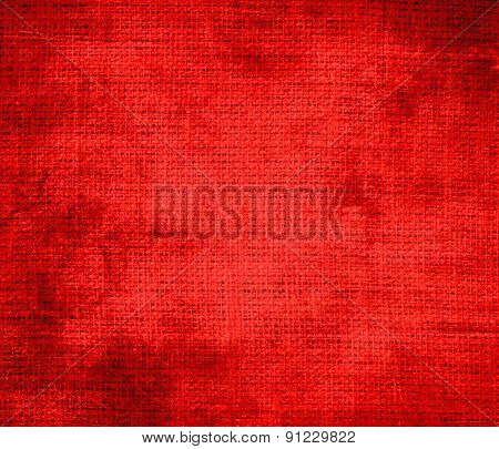 Grunge background of candy apple red burlap texture