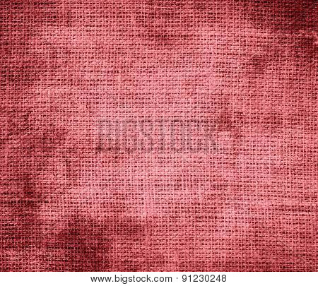 Grunge background of candy pink burlap texture