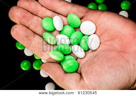 Mints In A Hand's Palm