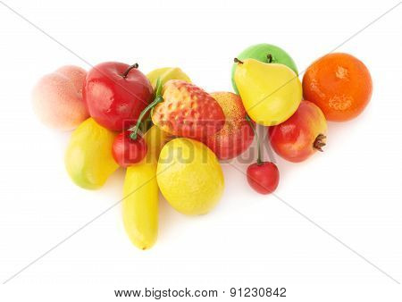 Pile of multiple artificial plastic fruits and berries