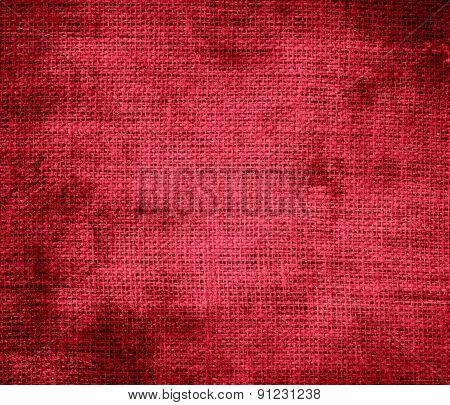 Grunge background of cardinal burlap texture