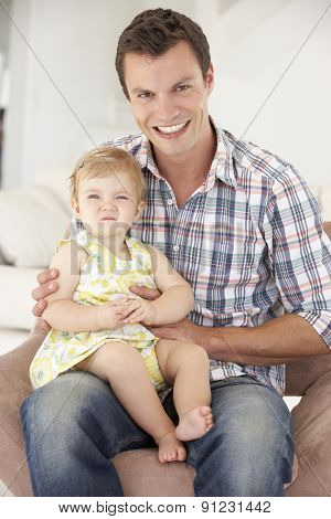 Father Relaxing with Daughter At Home