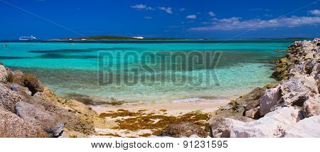 Beautiful caribbean beach with clear blue water.