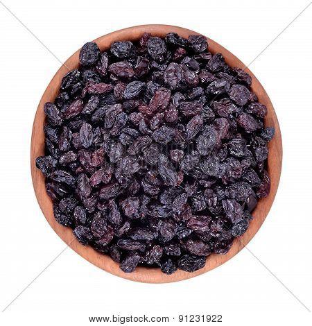 Dark Raisins In A Wooden Bowl