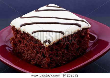 Square Slice Of Red Velvet Cake On Crimson Plate