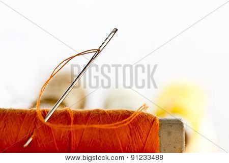 Needles And Orange Color Thread
