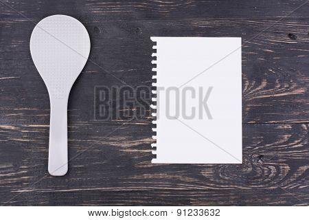 Plastic Spoon And Sheet Of Paper