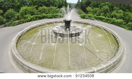 Close up view of fountain in park at summer sunny day. Aerial view
