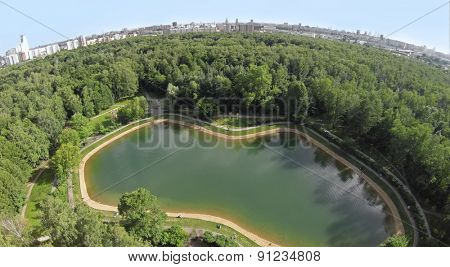 Aerial view pond among plants in park Sokolniki at summer sunny day.