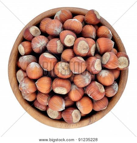 Hazelnuts In A Wooden Bowl On A White Background