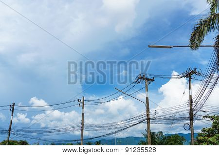 Raw Of Tangle Wire Pole Under The Big Skies
