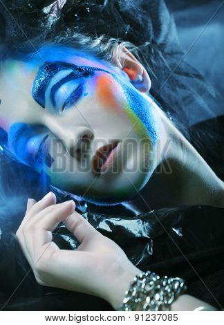 Beautiful Woman's Face studio shot, bright make up
