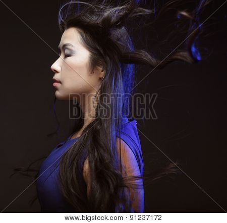 asian fashion woman with wind in the hair