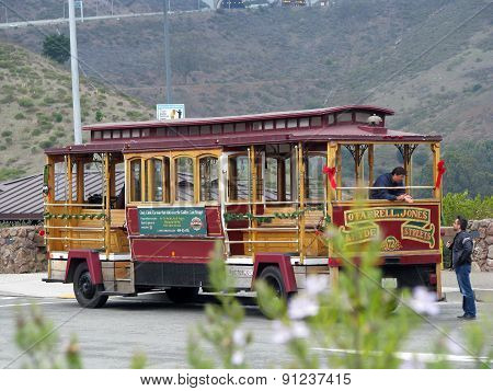 SAN FRANCISCO, CA - NOVEMBER 16: O'Farrell-Jones-Hyde Streets 72 Cable Car parked at Golden Gate Bri