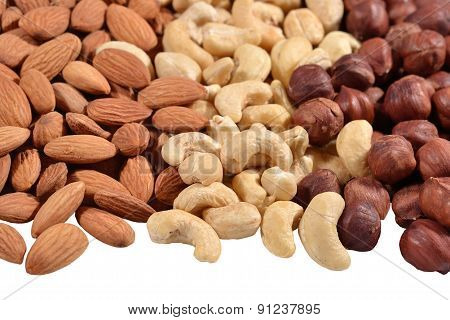 Heap Of Assorted Nuts On A White