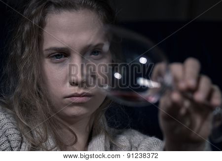 Alcoholic Holding Empty Glass