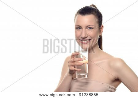 Pretty Young Woman Holding A Glass Of Water