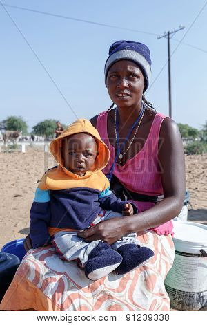 Small Namibian Child With Mother