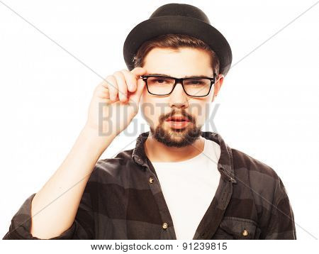 emotional, happiness and people concept:. Young man  wearing black hat.Studio shot over white background.